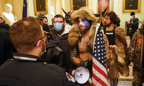 US Capitol riot: the myths behind the tattoos worn by 'QAnon shaman' Jake Angeli