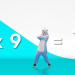 A woman in a unicorn onesie dancing while teaching maths.